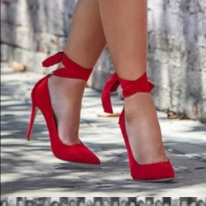 Red shoe dazzle heels with a tie